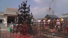 Pan WS of people performing ritual in Tirupati, India Stock Footage