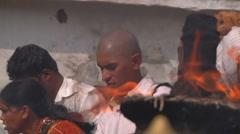 Pan MS of people performing ritual in Tirupati, India Stock Footage