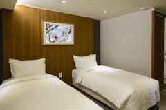 Twin hotel room interior - stock photo
