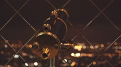 Eiffel tower telescope overlooking the city of Paris by night Stock Footage