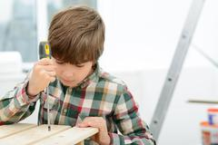 Little boy holding screwdriver - stock photo