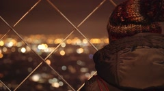 Tourist looking at the city from Eiffel tower top Stock Footage