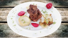 Stock Video Footage of beef bourguignon in wine with artichoke and marinated vegetables
