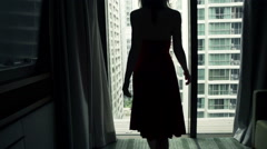 Young woman admire view from window at home, super slow motion 240fps Stock Footage