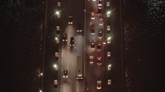Aerial view of traffic on a bridge - Paris nightscape - stock footage
