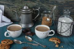 Coffee with milk and homemade oatmeal cookies - stock photo