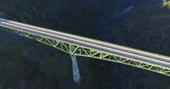 Panning over the Foresthill Bridge from High Above Stock Footage