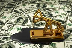Golden Pumpjack And Spilled Oil On The Dollars - stock photo