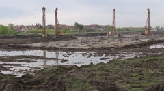 Pile driving machine in construction site. - stock footage