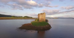 Aerial shot of Castle Stalker on the west coast of Scotland Stock Footage