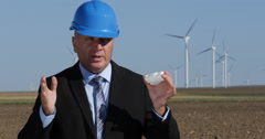 Engineer Present Electrical Plug Outlet TV Interview Wind Power Plant Farm Stock Footage