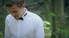 The bride kisses the groom in the forest - stock footage