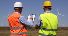 Maintenance Engineers Team Check Technical Drawings Windmills Energy Producing Stock Footage