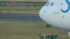 Airbus 330 towing to service Stock Footage