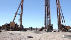 Construction site with big equipment for drilling into the ground. - stock footage