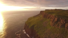 Stunning aerial shot along the coast on the Isle of Skye during a sunset Stock Footage