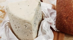 Stock Video Footage of deli fresh blue stilton cheese and rye ciabatta