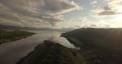 Aerial shot on the west coast of Scotland near Oban showing a bay with boats Stock Footage