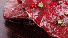 Stock Video Footage of raw beef fillet mignon on old retro style wood