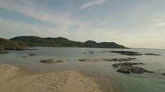 Aerial shot along the beach on the coastline during a sunset at Ardnamurchan Stock Footage