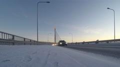 Beautiful vibrant scandinavian winter scene: Bridge over Kemijoki river Stock Footage