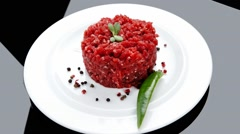 Stock Video Footage of big raw hamburger cutlet with sprouts and chilli pepper over bla