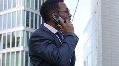 Young African American businessman in a business conversation using mobile phone Stock Footage