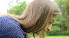 Young attractive woman fondle beloved french bulldog in the park  Stock Footage