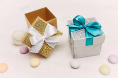Two gift boxes on vintage wood table - stock photo