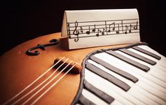 Cake In Shape of Piano and Cello Stock Photos