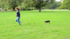 Young attractive happy woman run with french bulldog - she hold leash Stock Footage