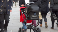 Pushchair and anonymous crowd in a pedestrian shopping street, France Stock Footage
