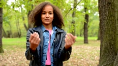 Young african charming generous girl with fluffy afro hair shows  Stock Footage