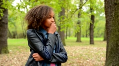 Young african thoughtful girl think about problems in the forest - she looks for Stock Footage