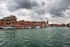 Murano island with its historic houses in Italy - stock photo