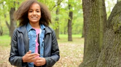Young charming lively african girl talk about herself in the forest  Stock Footage