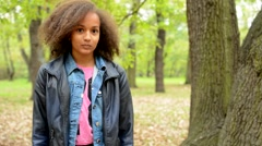 young beautiful sincere african girl nod her head as agree in the park  - stock footage