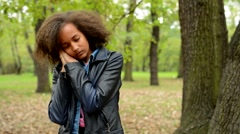 Young charming african girl wake up in the forest she freak out where she is  Stock Footage