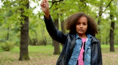 Young charming smart african girl raise her up to the sky and shake with her  Stock Footage
