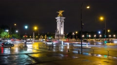 Evening traffic in front of the Pont Alexandre III in Paris Stock Footage