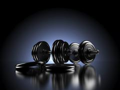 Dumbbells in front of backlit dark background - stock illustration