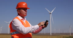Engineer Use Tablet Planning Future Location Wind Turbine Best Spin Rotation Stock Footage