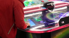 Playing air hockey game - stock footage