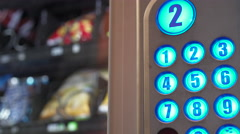 Vending machine used to purchase bag of chips 4k Stock Footage