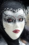 Bizarre woman in venetian mask - stock photo