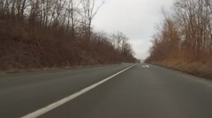 Gray gloomy day. Car moving in a narrow deserted road. Stock Footage