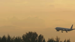 Boeing 777 approaching at sunset Stock Footage