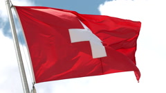Flag of Switzerland Waving in the Wind in Slow Motion Stock Footage