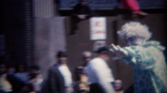 1964: Creepy clowns at parade salutes military heroes. BUFFALO, NEW YORK - stock footage