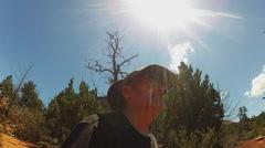 Man Hiking In Sedona Arizona Desert Under Sun With Flare Stock Footage